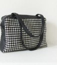 Katherine Emtage Elsie Day Bag black & white houndstooth with black leather angle