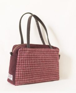 Katherine Emtage Elsie day Bag raspberry houndstooth dark cherry trim angle 2