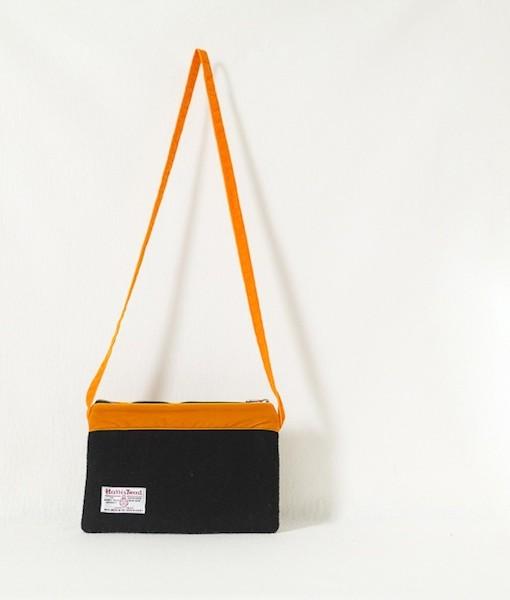 Katherine Emtage black Harris Tweed large pochette long tangerine strap reverse