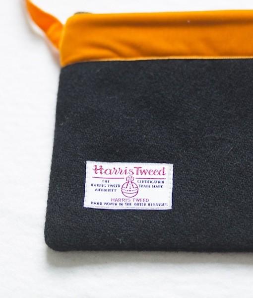 Katherine Emtage black Harris Tweed large pochette long tangerine strap reverse detail