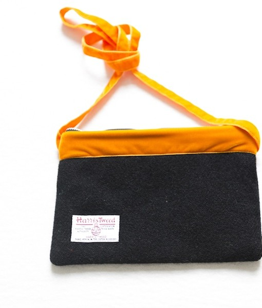 Katherine Emtage black Harris Tweed large pochette reverse tangerine long strap tied