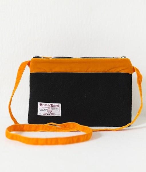 Katherine Emtage black Harris Tweed large pochette with tangerine velvet trim and long strap reverse