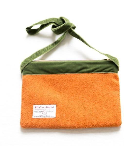 Katherine Emtage tangerine large pochette Harris Tweed long strap tied reverse